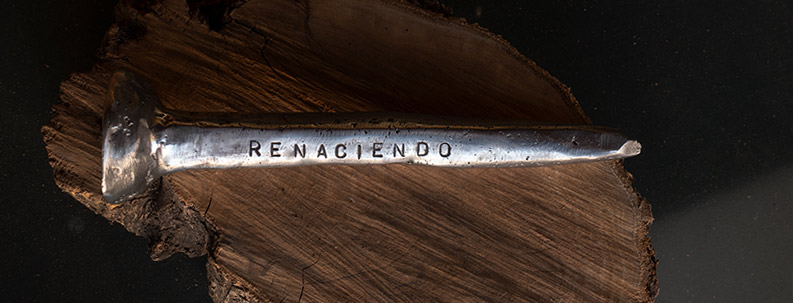 recycled aluminium hand forged into a period crucifixion nail stamped with the words Re-Born