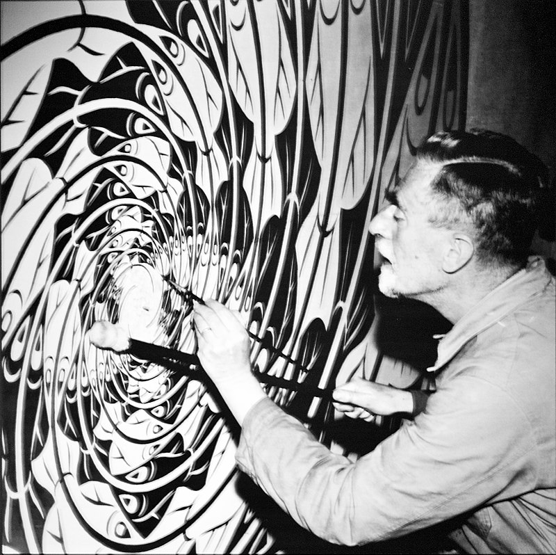Escher at work on Sphere Surface with Fish in his workshop, late 1950s
