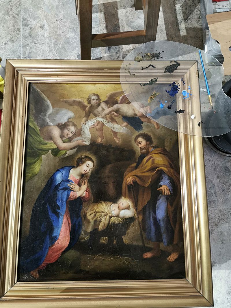 a painting restoration nears completion with a natural shellac glaze a pro-bono service to aide the church