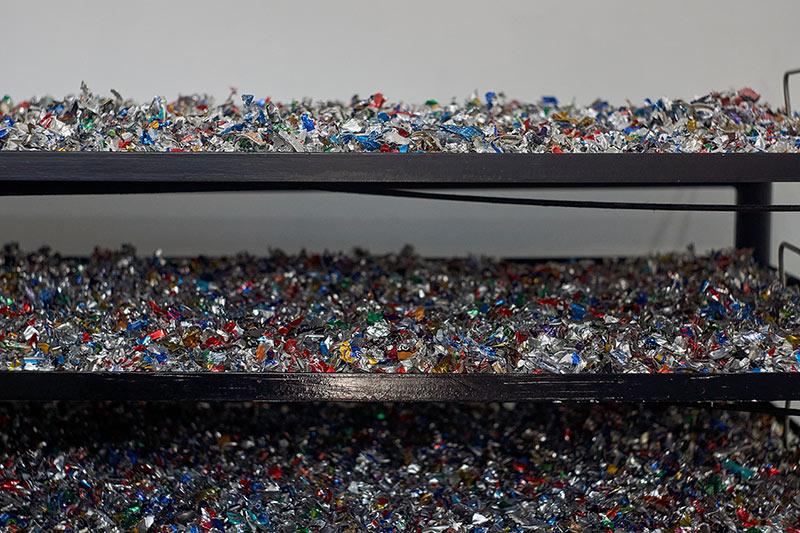 shredded aluminium in the wash station drying on racks