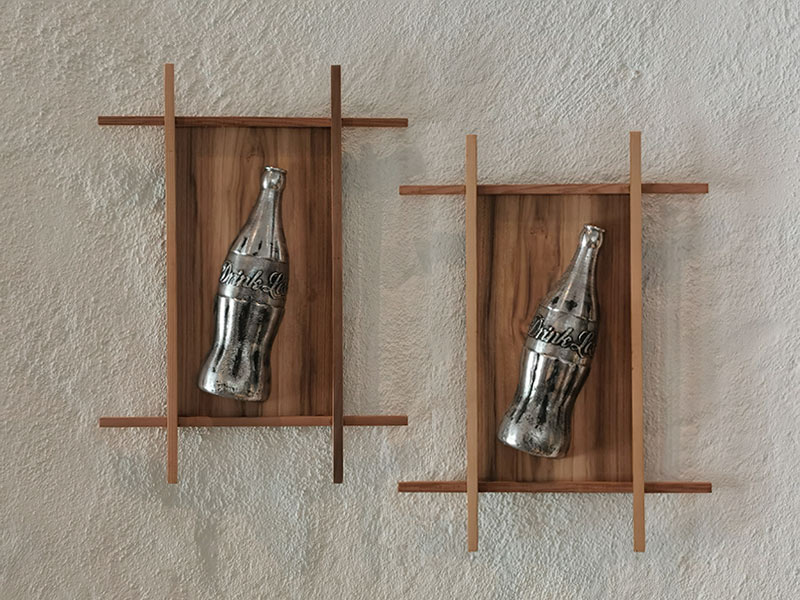 Drink Less aluminium sculptures based on the old glass style classic coke bottle