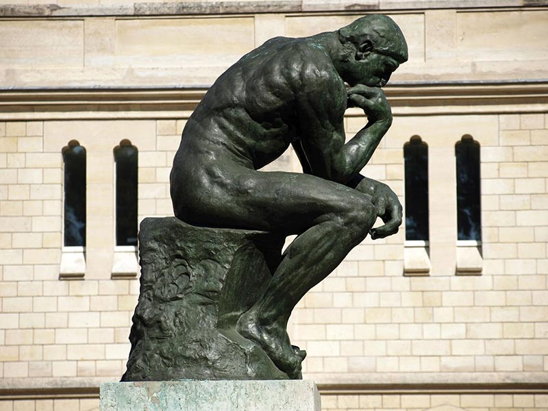 a contemporary artist reworks the Thinker by Auguste Rodin seen here in Museum garden Paris 1904