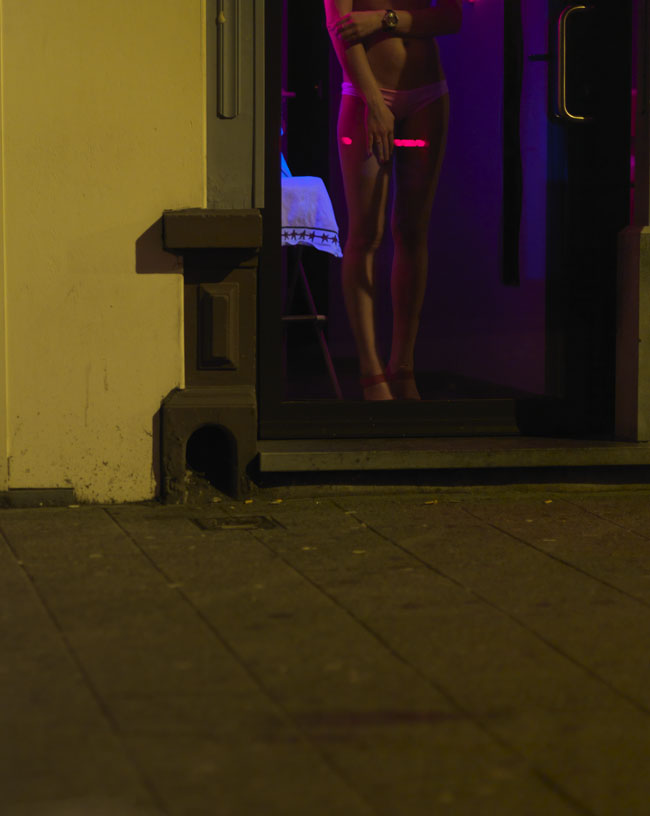 red light district of antwerp art series where artist depicts the predators of the sex industry