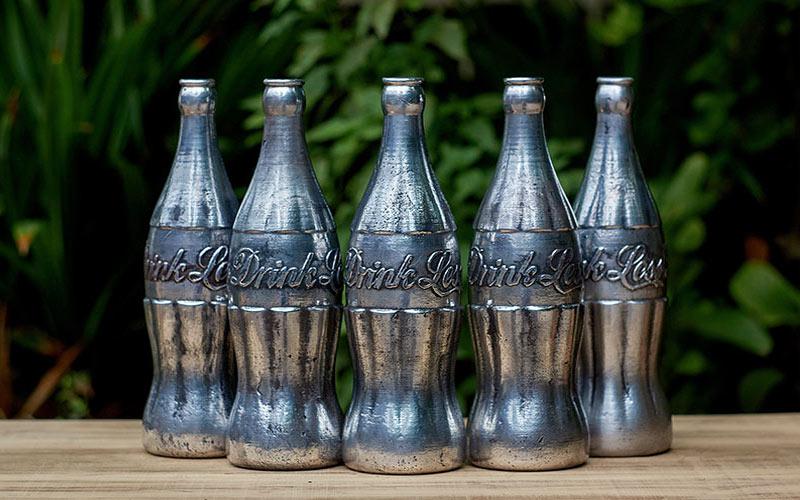 a contemporary artist reinterprets the classic glass coke bottle