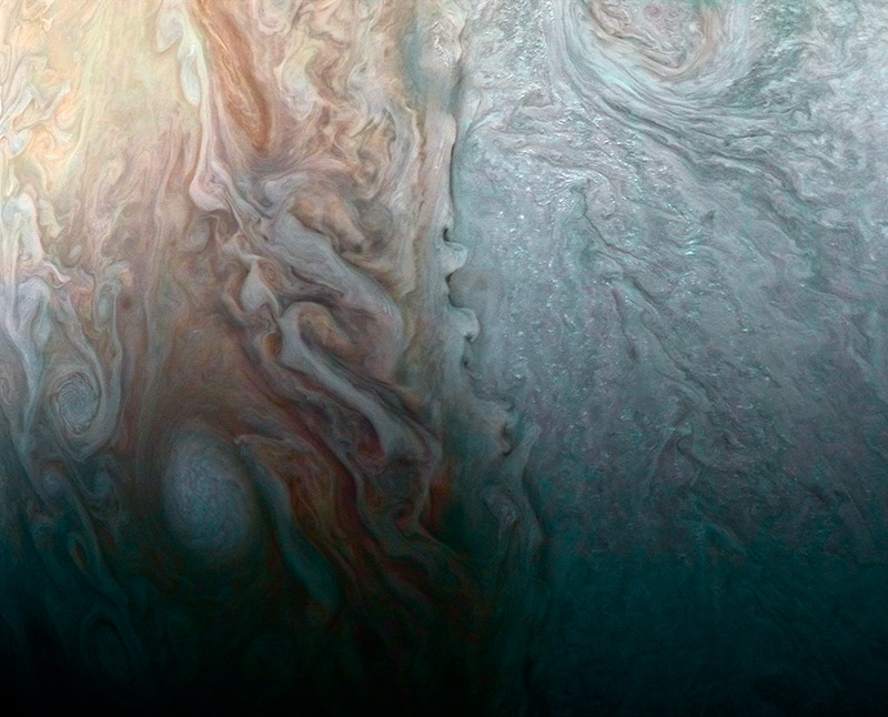 Lo is one of the 79 moons orbiting Jupiter, seen here against the vast backdrop of its parent planet.  This image was taken on the Cassini spacecrafts closest approach to Jupiter on its way to a permanent orbit around Saturn.