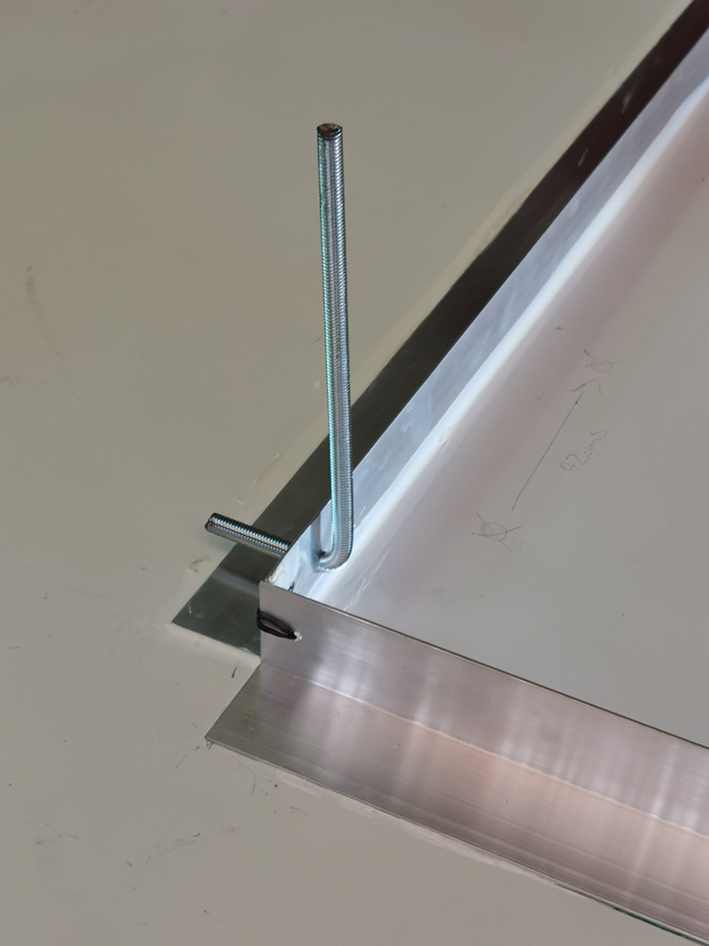 a good dibond hanging system was in my view clunky so we went about designing one ourselves
