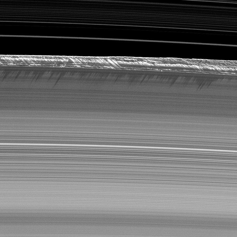 the ice mountains contained in the planet Saturns rings  - image copyright nasa